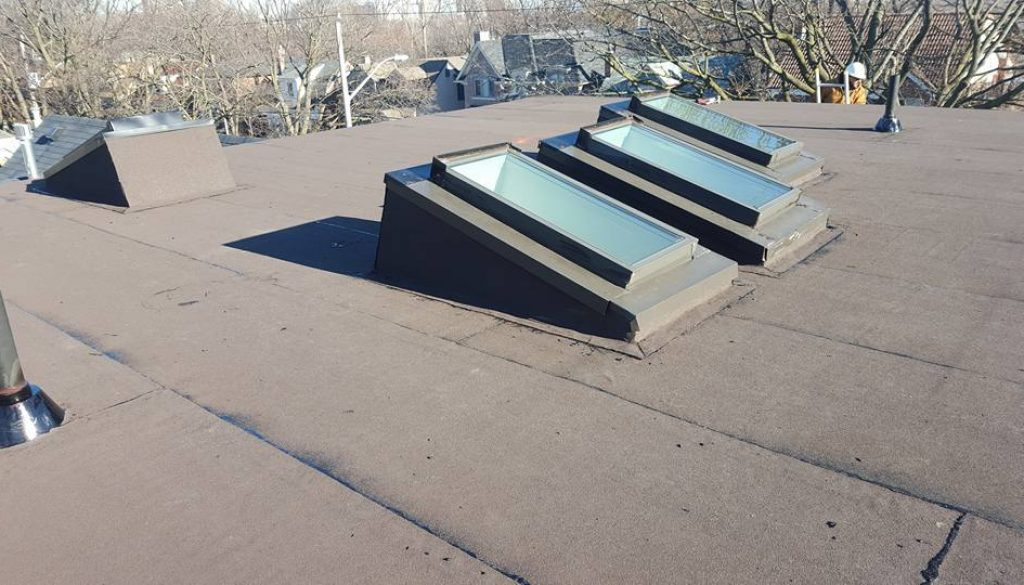 Flat Roof With Skylights Mega City Roofing Inc